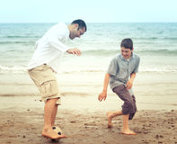 Father and son having fun on the beach Royalty Free Stock Images