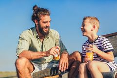 Father and son having fun at beach together. Portrait fun happy lifestyle stock photography