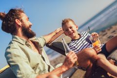 Father and son having fun at beach together. Portrait fun happy lifestyle royalty free stock photos