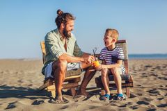 Father and son having fun at beach together. Portrait fun happy lifestyle stock images