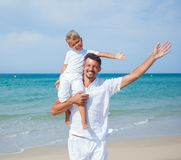 Father and son having fun on the beach Stock Photos