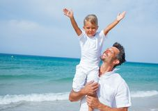 Father and son having fun on the beach Royalty Free Stock Photography