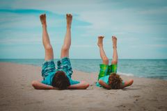Father and son having fun on beach. Vacation stock photography
