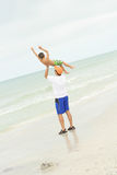Father & son having fun at the beach vertical. Shot of a father & son having fun at the beach vertical royalty free stock images