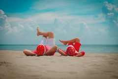 Father and son having fun on christmas beach. Vacation stock photography