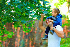 Father and son having fun in colorful nature Royalty Free Stock Photos