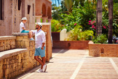Father and son having fun on cute tropical street Royalty Free Stock Photos