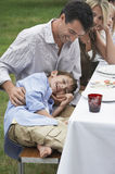 Father And Son Having Fun At Dining Table Royalty Free Stock Photography
