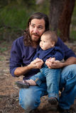 Father and son having fun in the forest Stock Photography