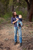 Father and son having fun in the forest. Father & son having a day of fun in the nature. Shallow DOF, focus on man's face Royalty Free Stock Photo