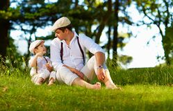Father and son having fun on forest lawn Stock Images