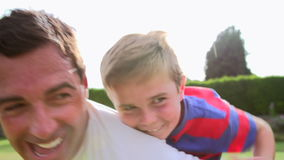 Father And Son Having Fun In Garden stock footage
