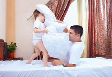 Father and son having fun at home, pillow fight Royalty Free Stock Images