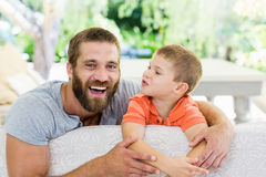 Father and son having fun in living room Royalty Free Stock Images