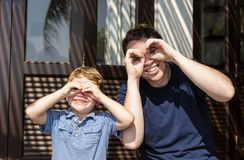 Father and son having fun making funny faces Stock Images