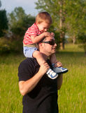 Father and son having fun in the nature Stock Image