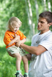 Father and son having fun outdoor Royalty Free Stock Images