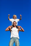 Father and son having fun outdoors Stock Images