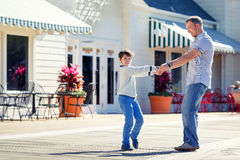 Father and son having fun outdoors in city Stock Photos
