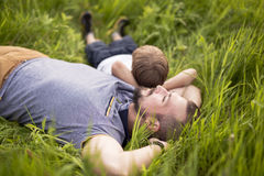 Father and son having fun outdoors in the meadow royalty free stock photo