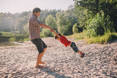 Father and son having fun outdoors Royalty Free Stock Photos