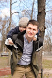 Father and son having fun outdoors on a spring sunny day Stock Photo