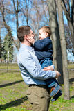 Father and son having fun outdoors on a spring sunny day Royalty Free Stock Photos