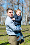 Father and son having fun outdoors on a spring sunny day Stock Photos