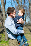 Father and son having fun outdoors on a spring sunny day Stock Image