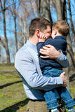 Father and son having fun outdoors on a spring sunny day Royalty Free Stock Photography