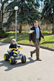 Father and son having fun outdoors on a spring sunny day Royalty Free Stock Photo