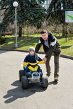 Father and son having fun outdoors on a spring sunny day Stock Photography