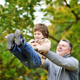 Father and son having fun in a park Stock Photography