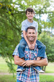 Father and son having fun in the park Royalty Free Stock Photography