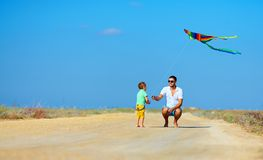 Father and son having fun, playing with kite together Stock Images