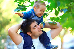 Father and son having fun playing outdoors Royalty Free Stock Photo