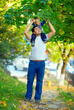 Father and son having fun playing outdoors Stock Photos
