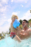 Father and son having fun in pool Stock Photos