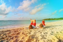 Father and son having fun on beach. Father and son having fun relax on tropical beach stock images