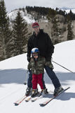Father and Son Having Fun on the Ski Slopes Royalty Free Stock Photography