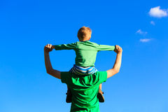 Father and son having fun on sky Stock Images