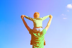 Father and son having fun on sky Royalty Free Stock Image