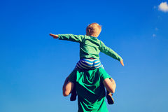 Father and son having fun on sky Royalty Free Stock Photography