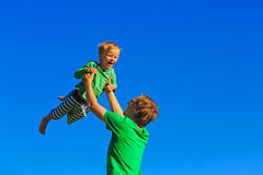 Father and son having fun on sky Royalty Free Stock Images