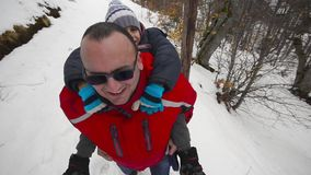 Father and son having fun on the snow stock footage