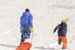 Father and son having fun in the snow stock photos