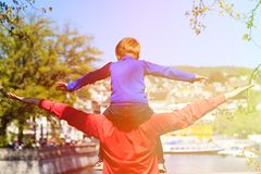 Father and son having fun in spring city Royalty Free Stock Photos