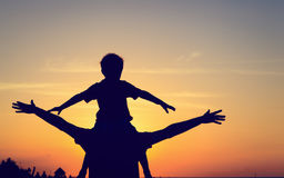 Father and son having fun at sunset Royalty Free Stock Photography