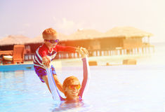 Father and son having fun in swimming pool Stock Photography