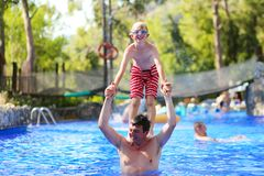 Father and son having fun in swimming pool Stock Photo